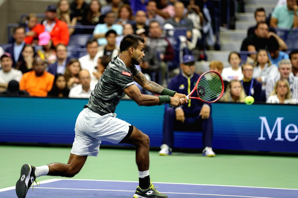 NEW YORK, Aug. 27, 2019 - Sumit Nagal of India hits a return during the men's singles first round match between Roger Federer of Switzerland and Sumit Nagal of India at the 2019 US Open in New York, ...