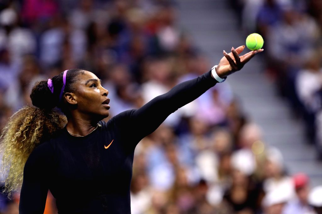 NEW YORK, Aug. 27, 2019 (Xinhua) -- Serena Williams of the United States serves during the women's singles first round match between Serena Williams of the United States and Maria Sharapova of Russia at the 2019 US Open in New York, the United States