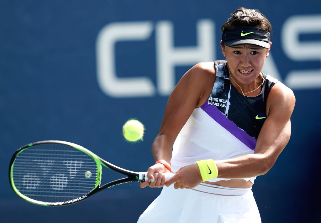 NEW YORK, Aug. 28, 2019 - Wang Xiyu of China hits a return during the women's singles first round match between Kirsten Flipkens of Belgium and Wang Xiyu of China at the 2019 US Open in New York, the ...
