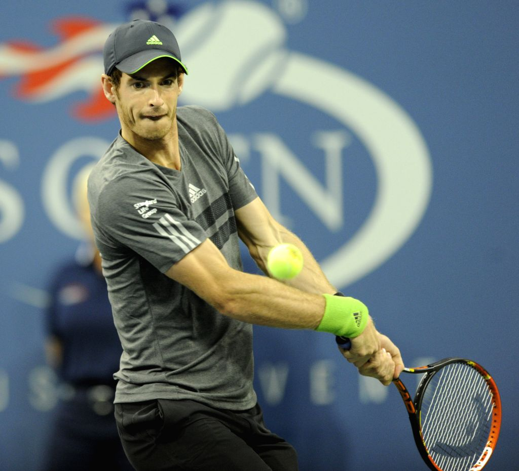 Andy Murray of Britain returns a shot during the second round match of men's singles against Matthias Bachinger of Germany at the 2014 U.S. Open in New York, the ..