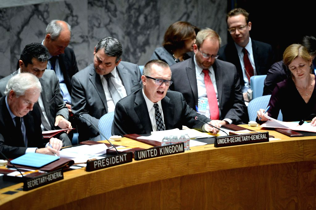 UN Under Secretary-General for Political Affairs Jeffrey Feltman (C) attends an emergency meeting of the UN Security Council to discuss the Ukraine crisis, at the