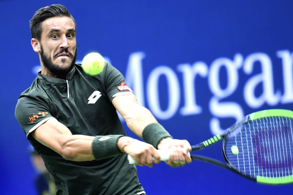 NEW YORK, Aug. 29, 2019 - Damir Dzumhur of Bosnia and Herzegovina hits a return during the men's singles 2nd round match between Roger Federer of Switzerland and Damir Dzumhur of Bosnia and ...