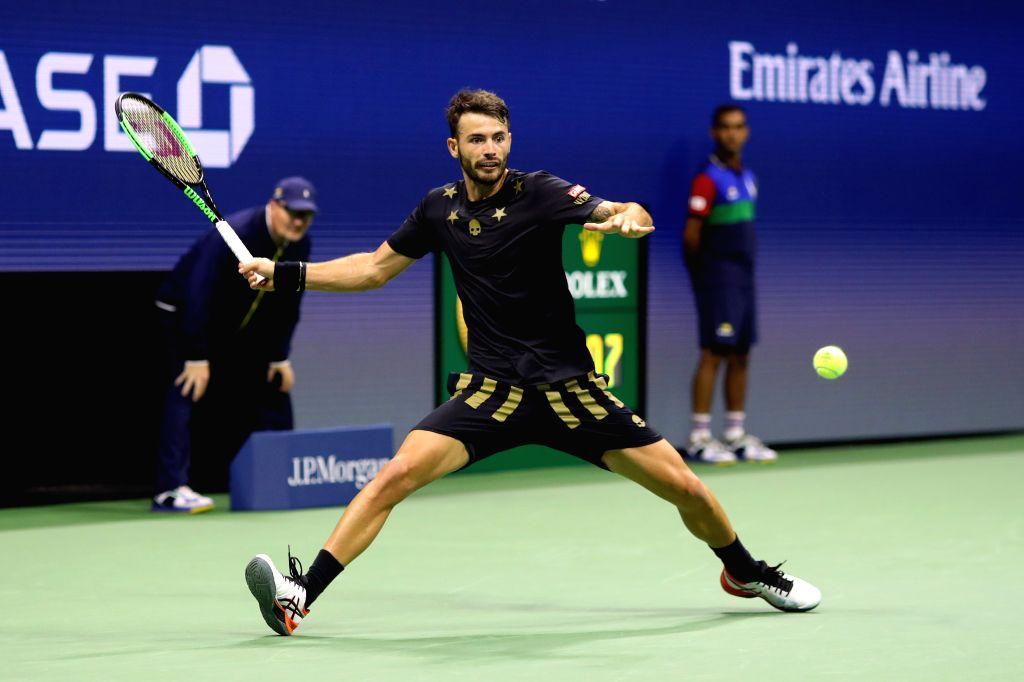 NEW YORK, Aug. 29, 2019 - Juan Ignacio Londero of Argentina hits a return during the men's singles 2nd round match between Novak Djokovic of Serbia and Juan Ignacio Londero of Argentina at the 2019 ...