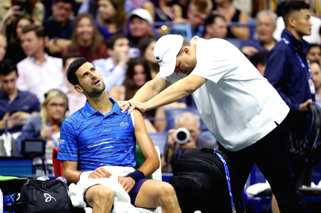 NEW YORK, Aug. 29, 2019 - Novak Djokovic (L) of Serbia receives a massage during the men's singles 2nd round match between Novak Djokovic of Serbia and Juan Ignacio Londero of Argentina at the 2019 ...