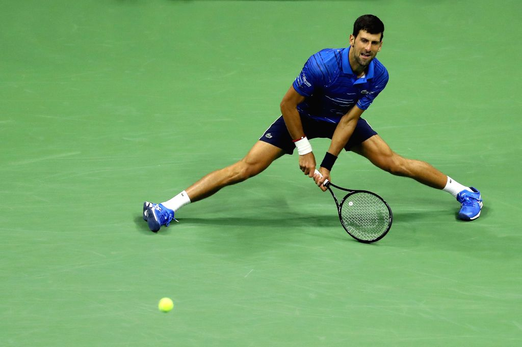 NEW YORK, Aug. 29, 2019 - Novak Djokovic of Serbia hits a return during the men's singles 2nd round match between Novak Djokovic of Serbia and Juan Ignacio Londero of Argentina at the 2019 US Open in ...