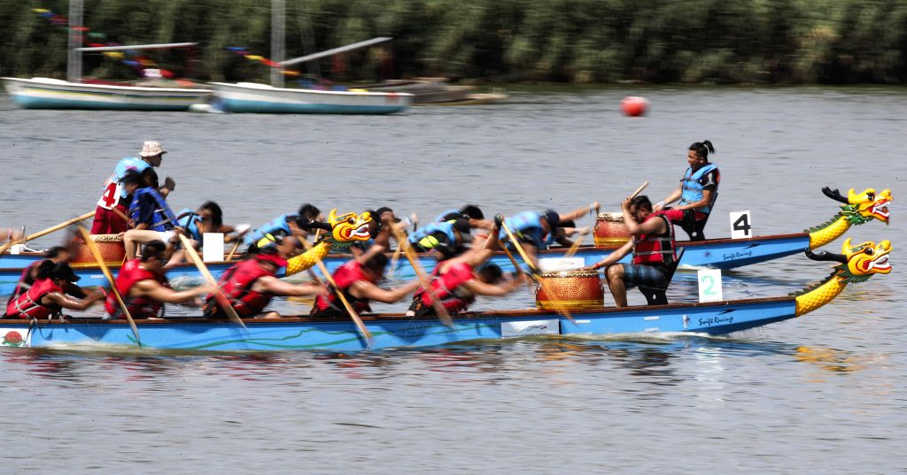 NEW YORK, Aug. 3, 2019 - Participants compete during the 29th Hong Kong Dragon Boat Festival in New York, the United States, Aug. 3, 2019. More than 2,500 rowers gathered at the Corona Park in New ...