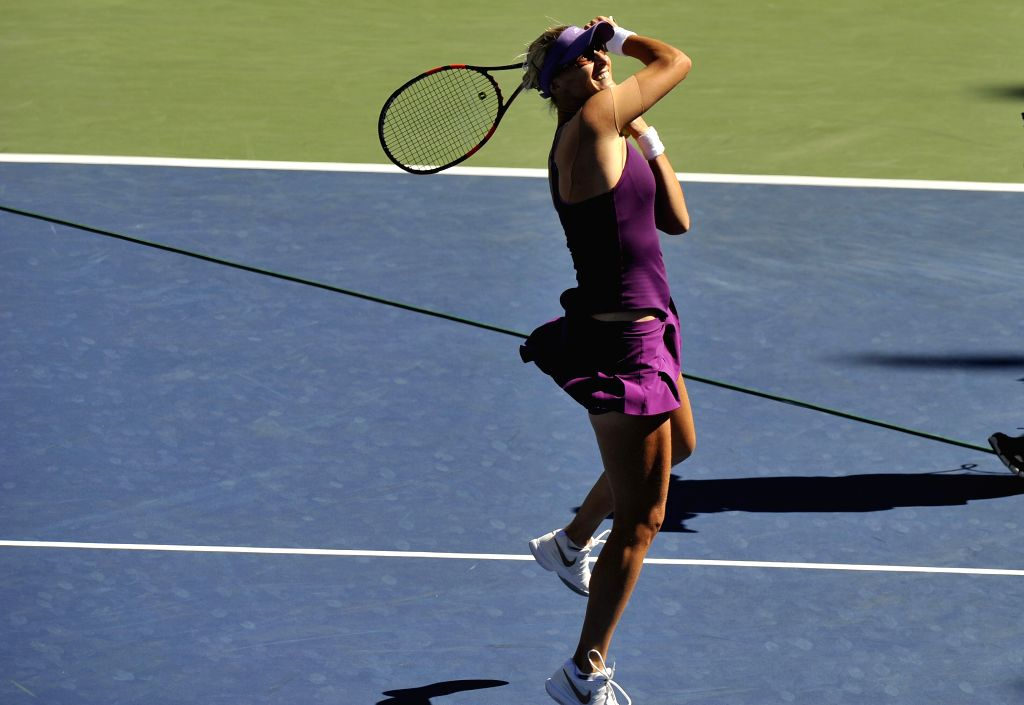 Mirjana Lucic-Baroni of Croatia celebrates after the third round match of women's singles against Simona Halep of Romania at the 2014 U.S. Open in New York, the ...