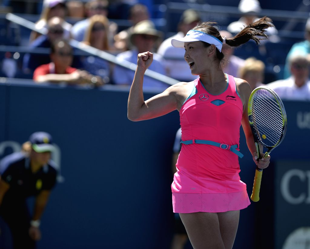 Peng Shuai of China jubilates after the third round match of women's singles against Roberta Vinci of Italy at the 2014 U.S. Open in New York, the United States, ..