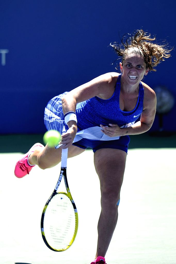 Roberta Vinci of Italy serves during the third round match of women's singles against Peng Shuai of China at the 2014 U.S. Open in New York, the United States, ...