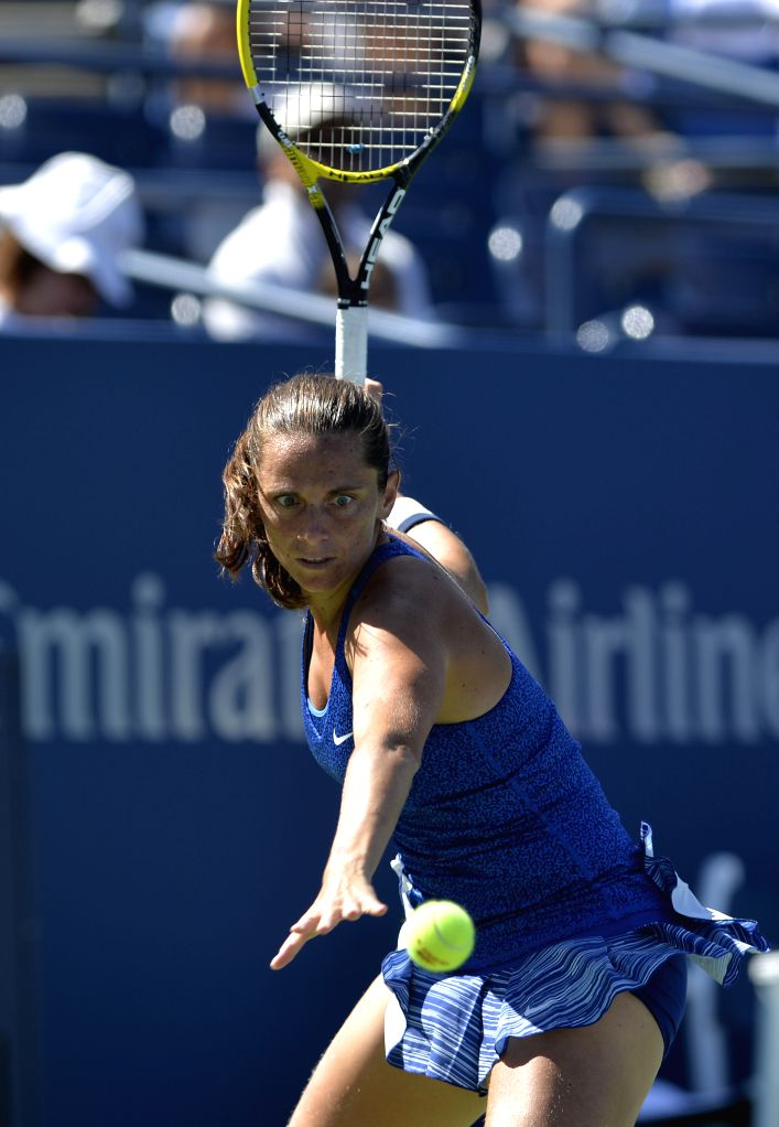 Roberta Vinci of Italy returns a shot during the third round match of women's singles against Peng Shuai of China at the 2014 U.S. Open in New York, the United ...