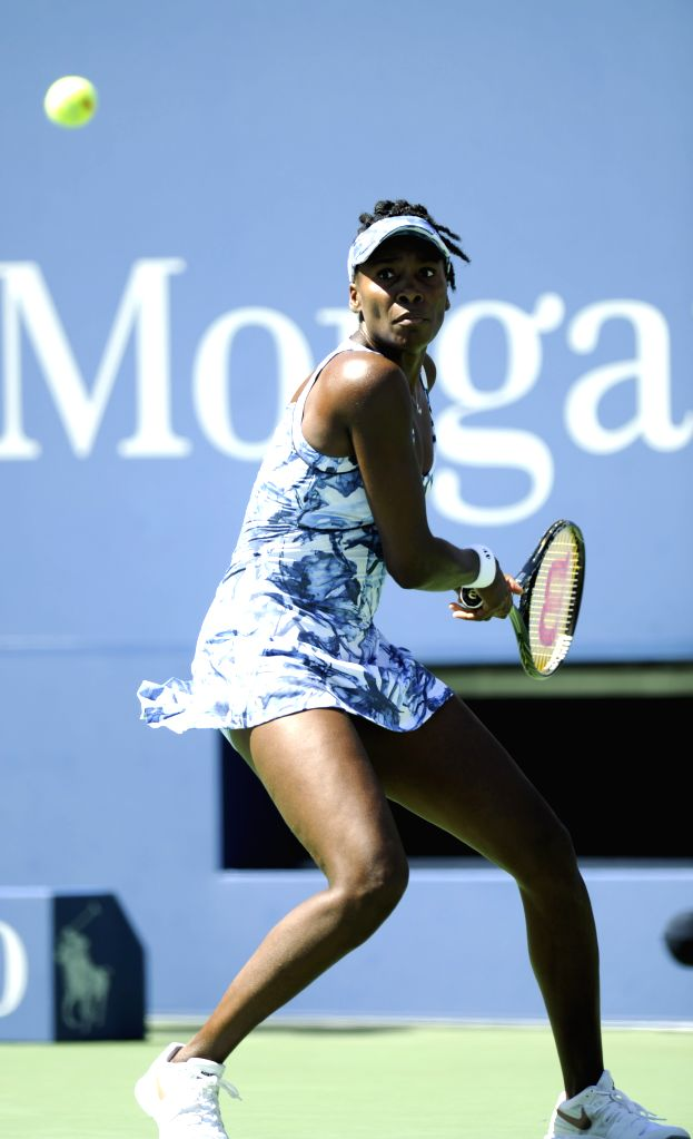 Venus Williams of the United States returns a shot during the third round match of women's singles against Sara Errani of Italy at the 2014 U.S. Open in New York, .