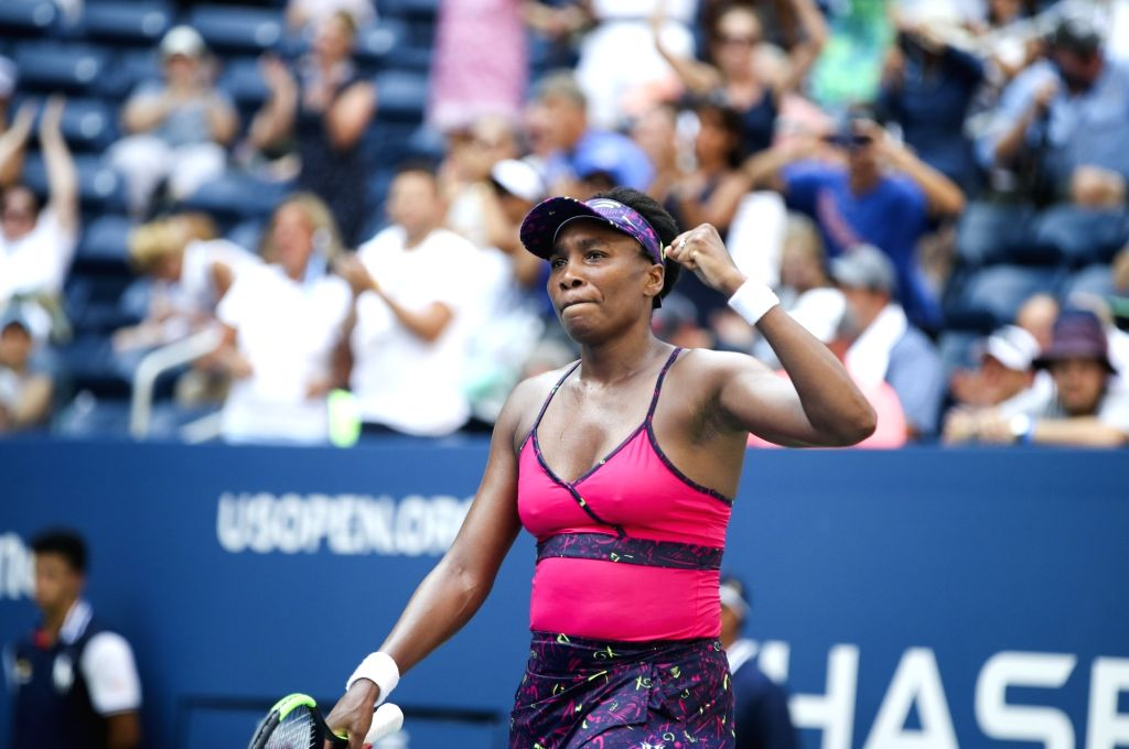 NEW YORK, Aug. 30, 2018 (Xinhua) -- Venus Williams of the United States celebrates after winning the women's singles second round match against Camila Giorgi of Italy at the 2018 US Open tennis Championships in New York, the United States, Aug. 29, 2
