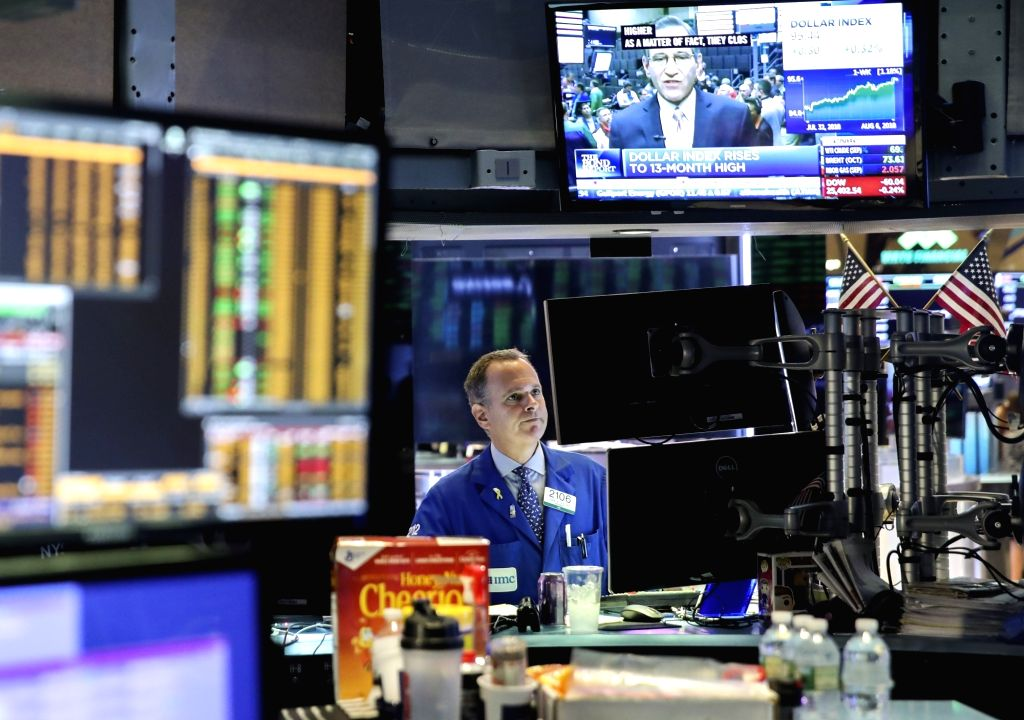NEW YORK, Aug. 6, 2018 - A trader works at the New York Stock Exchange in New York, the United States, Aug. 6, 2018. U.S. stocks closed higher on Monday as investors digested a batch of ...