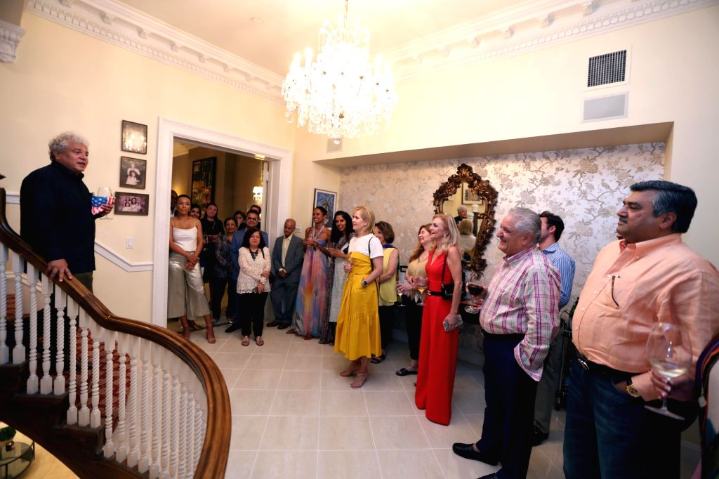 New york: Author Suhel Seth addresses a gathering during a reception organised at The Giving Back Foundation Founder and CEO Meera Gandhi's residence, in New York on Sept 3, 2018. - Suhel Seth and Meera Gandhi