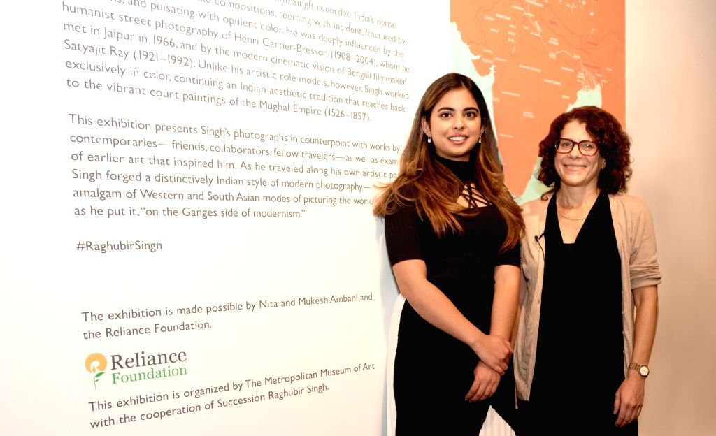 New York: Business tycoon Mukesh and Nita Ambani's daughter Isha Ambani with Mia Fineman, Curator of the Raghubir Singh exhibit at the Metropolitan Museum of Art in New York, where Reliance ... - Nita Ambani, Isha Ambani and Raghubir Singh