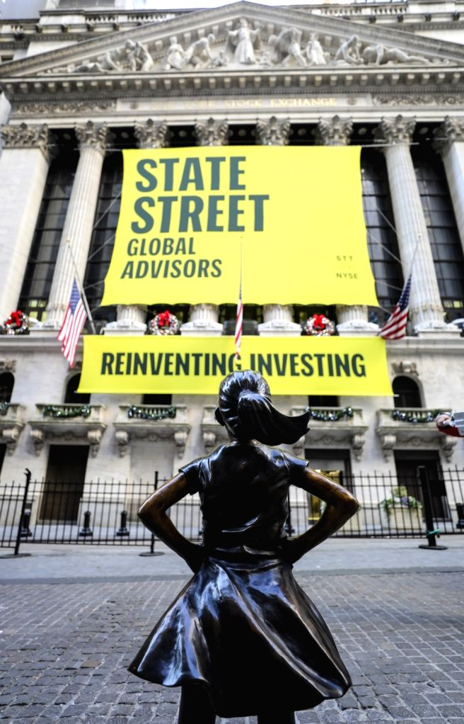 """NEW YORK, Dec. 10, 2018 - """"Fearless Girl"""" is seen on the street in front of the New York Stock Exchange in New York, the United States, Dec. 10, 2018. """"Fearless Girl,"""" a ..."""