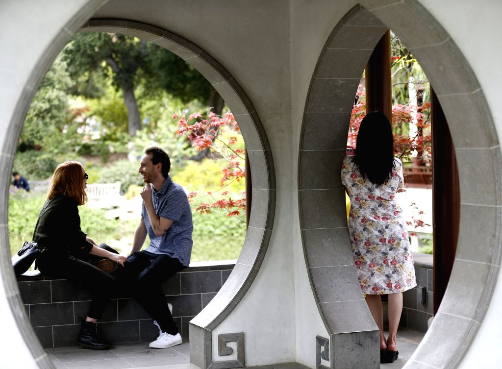 NEW YORK, Dec. 12, 2019 - People visit the Chinese garden Liu Fang Yuan in the Huntington Library, Art Collections and Botanical Gardens in Los Angeles, the United States, April 21, 2019. Inspired by ...