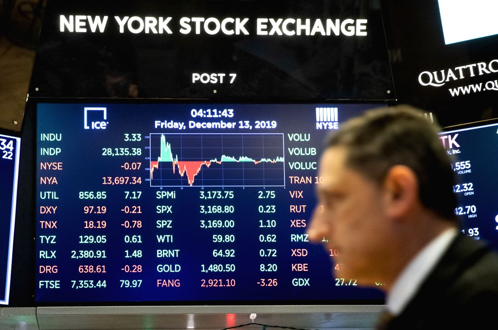 NEW YORK, Dec. 13, 2019 - An electronic screen shows the trading data at the New York Stock Exchange in New York, the United States, on Dec. 13, 2019. U.S. stocks ended higher on Friday as investors ...