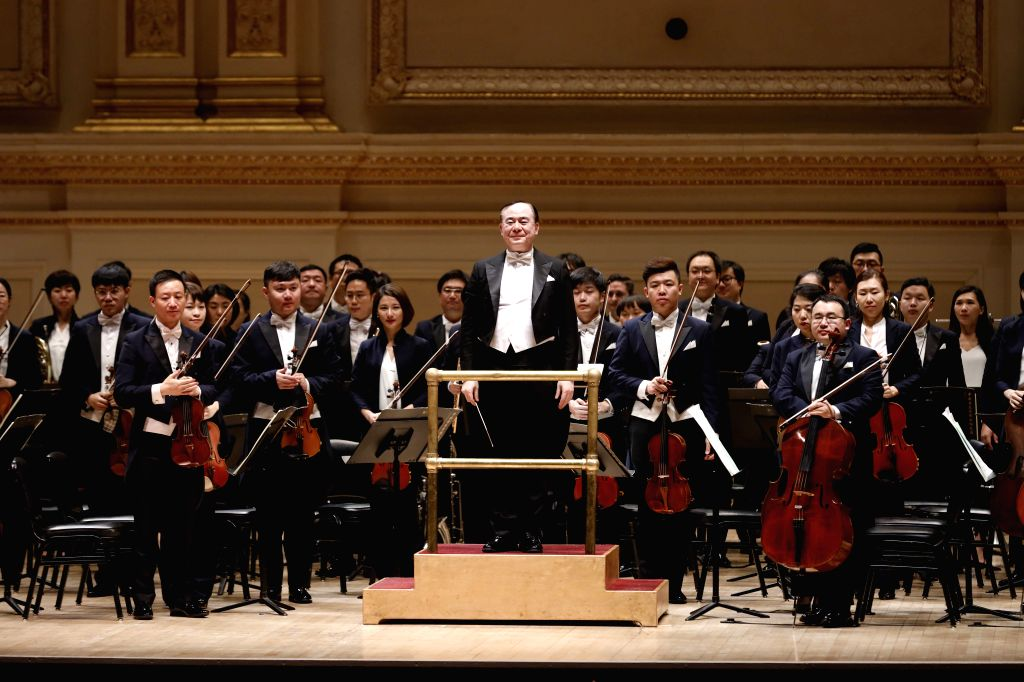 NEW YORK, Dec. 15, 2019 - Symphony Orchestra of the Central Conservatory of Music (CCOM) of Beijing greets the audience at the Carnegie Hall in downtown Manhattan, New York, the United States, Dec. ...