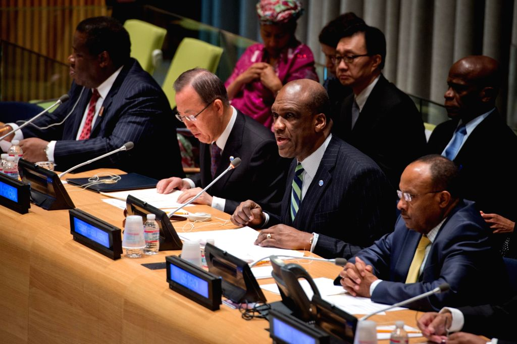 United Nations General Assembly President John Ashe (2nd R front) speaks during a special meeting of the UN General Assembly in honor of the life and memory ..