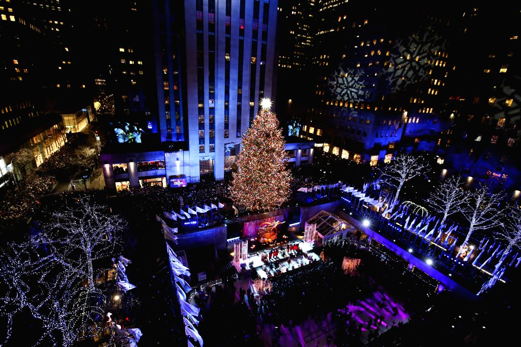 NEW YORK, Dec. 21, 2018 (Xinhua) -- Photo taken on Nov. 28, 2018 shows the Rockefeller Center Christmas tree after it was lit in New York, the United States. A ceremony was held on Wednesday night in Midtown Manhattan to light the Rockefeller Center