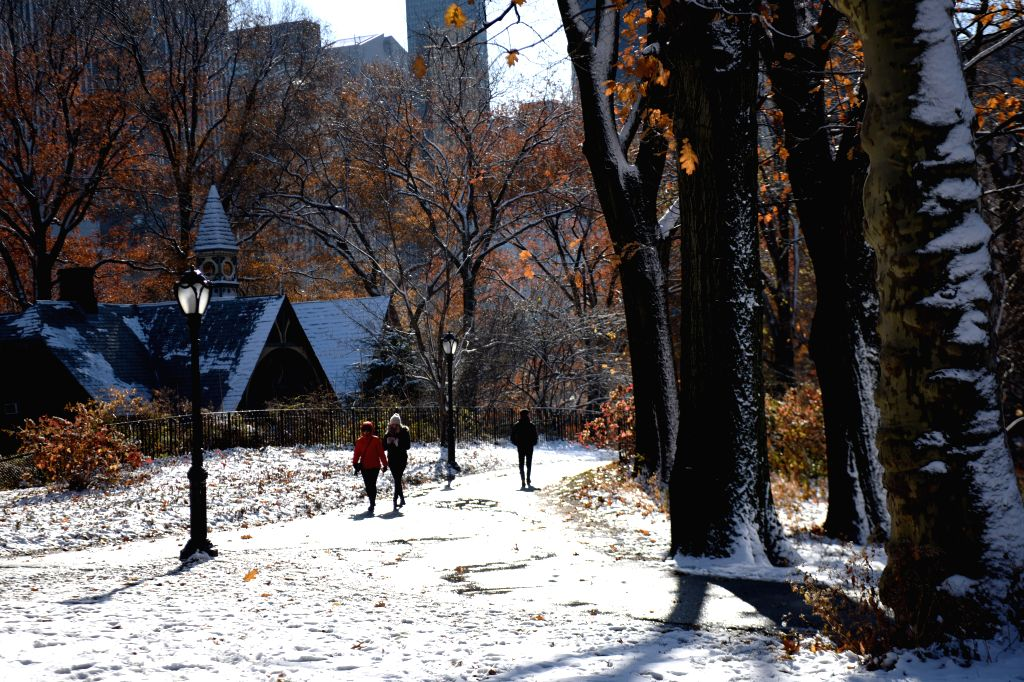 NEW YORK, Dec. 3, 2019 - Visitors enjoy the snow scenery in Central Park in New York, the United States, on Dec. 3, 2019. The first snowfall of the season hit New York City on Monday.