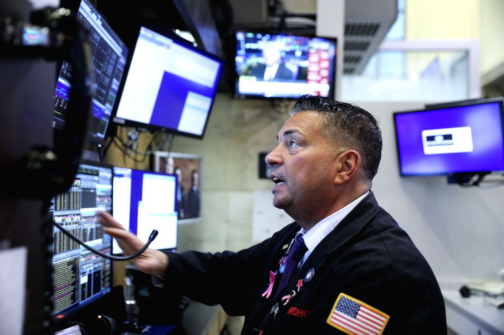NEW YORK, Dec. 4, 2019 - A trader works at New York Stock Exchange in New York, the United States, Dec. 3, 2019. U.S. stocks closed lower on Tuesday as investors monitored the latest development of ...