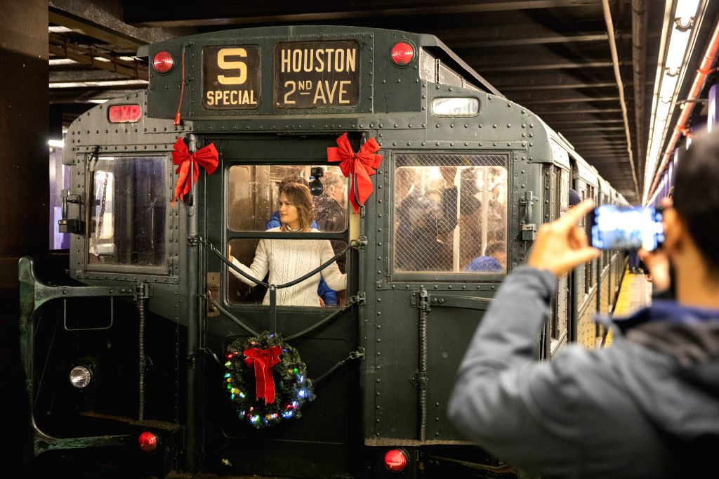 NEW YORK, Dec. 8, 2019 - People take a ride in a vintage subway car during Holiday Nostalgia Rides in New York's subway, the United States, Dec. 8, 2019. Every Sunday between Thanksgiving and New ...