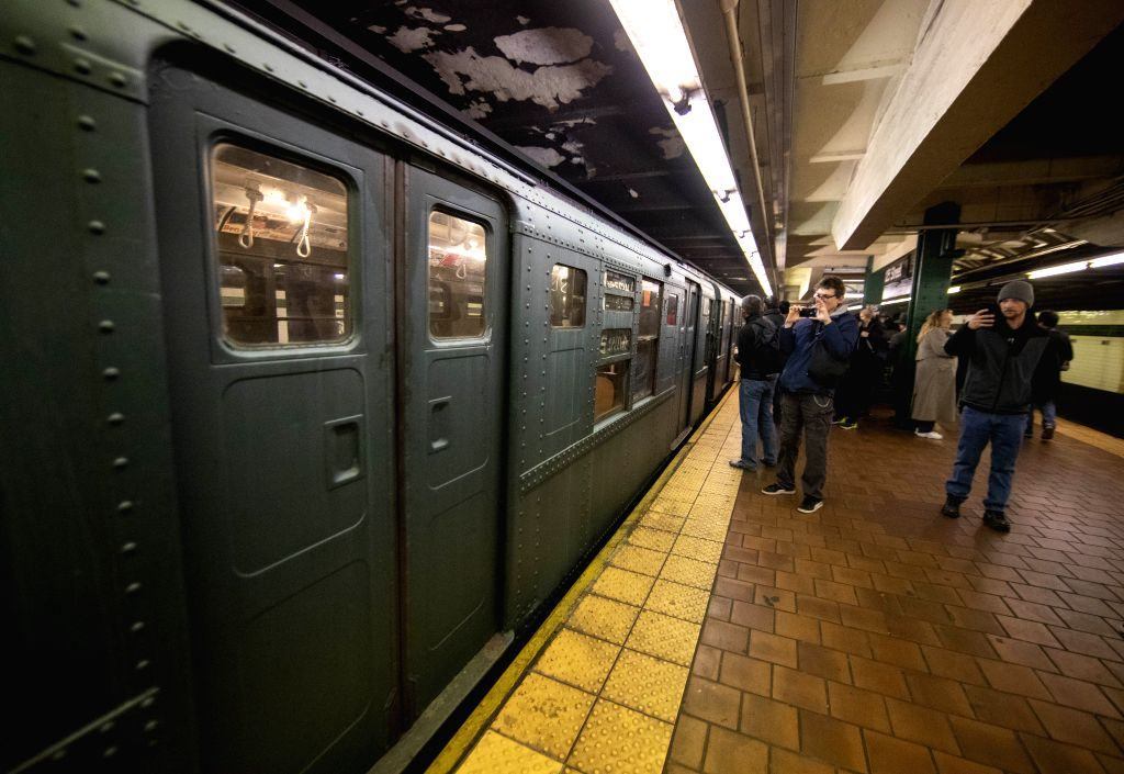 NEW YORK, Dec. 8, 2019 - People take photo of a vintage subway car during Holiday Nostalgia Rides in New York's subway, the United States, Dec. 8, 2019. Every Sunday between Thanksgiving and New ...