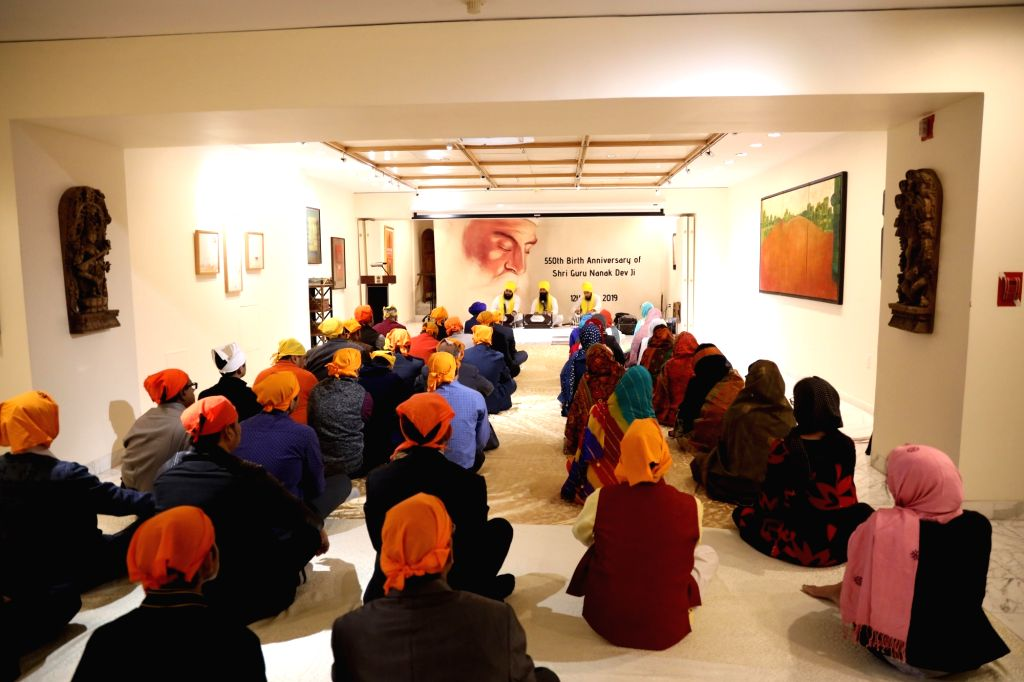 New York: Devotees participate in the 550th birth anniversary celebrations of Guru Nanak Dev in New York, US on Nov 12, 2019. - Nanak Dev
