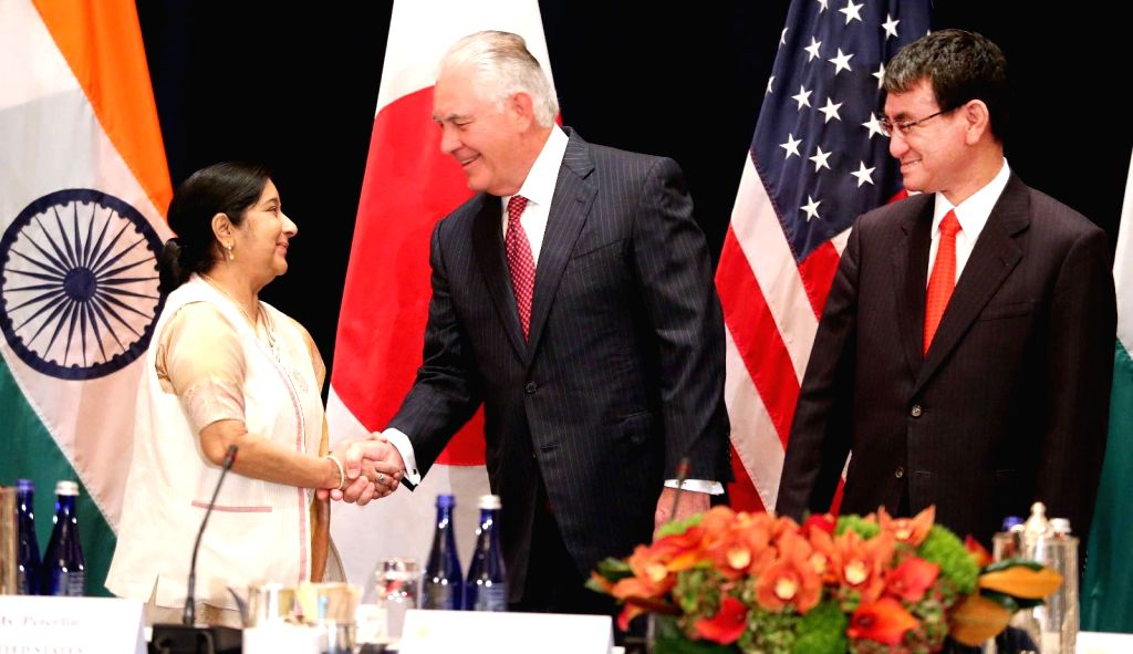 New York: External Affairs Minister Sushma Swaraj with United States Secretary of State Rex Wayne Tillerson and Japanese Foreign Minister Fumio Kishida at the commencement of a trilateral meeting ... - Sushma Swaraj