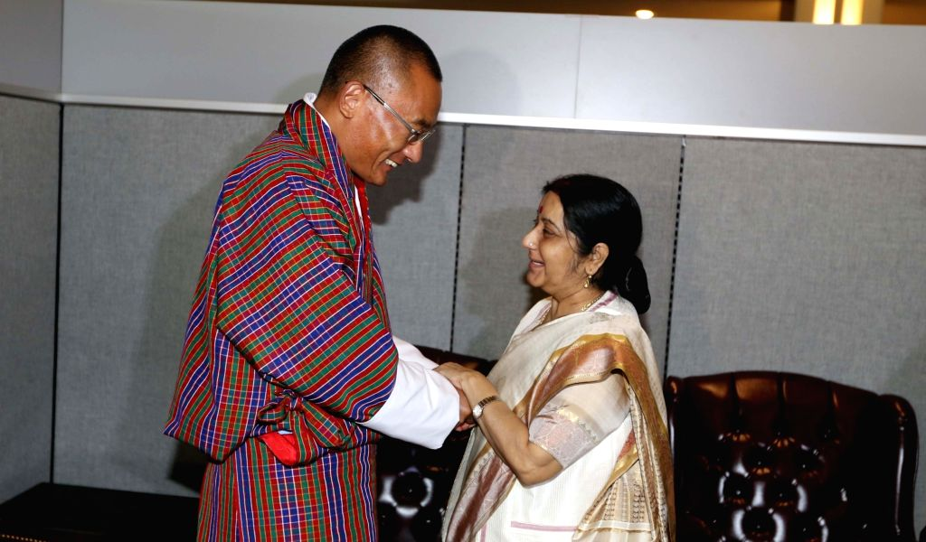 New York: External Affairs Minister Sushma Swaraj meets Bhutan's Prime Minister Tshering Tobgay on the sidelines of the United Nations General Assembly (UNGA) at the United Nations headquarters in ... - Sushma Swaraj
