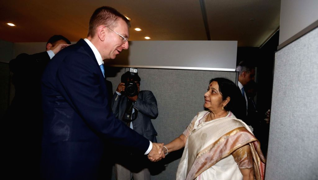 New York: External Affairs Minister Sushma Swaraj meets Latvian Foreign Minister Edgars Rinkevics on the sidelines of the annual UN General Assembly (UNGA) session at the United Nations headquarters ... - Sushma Swaraj