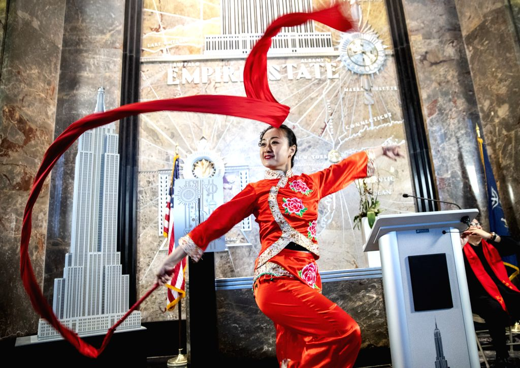 NEW YORK, Feb. 1, 2019 - A dancer performs during the lighting ceremony for Chinese Spring Festival at the Empire State Building in Manhattan, New York, the United States, on Feb. 1, 2019. The top of ...