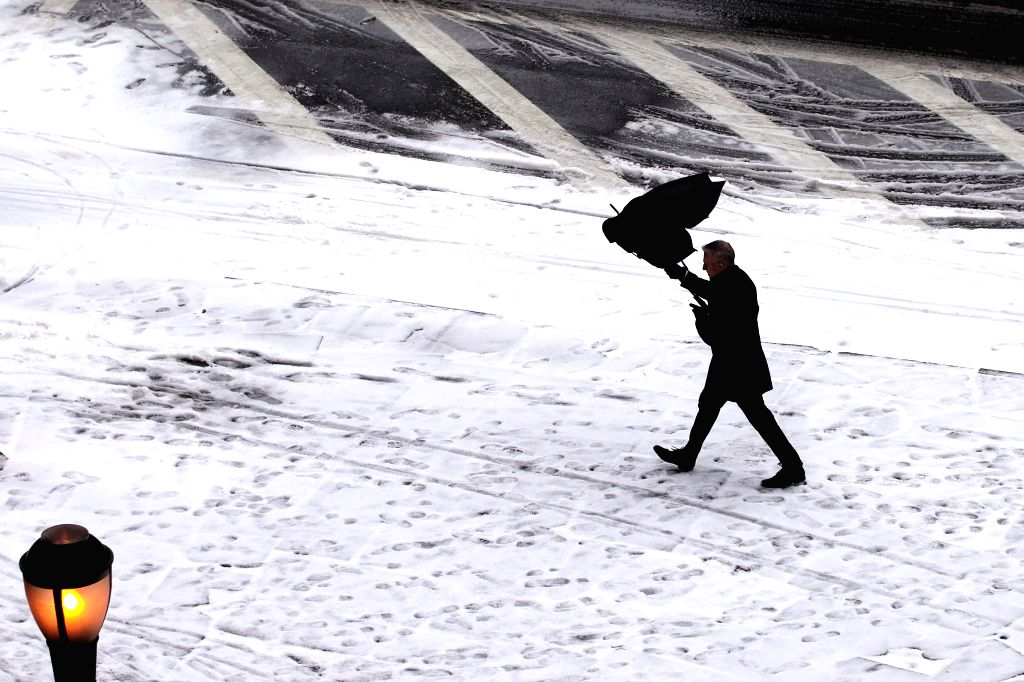 NEW YORK, Feb. 12, 2019 - A pedestrian walks in the snow in New York, the United States, on Feb. 12, 2019.