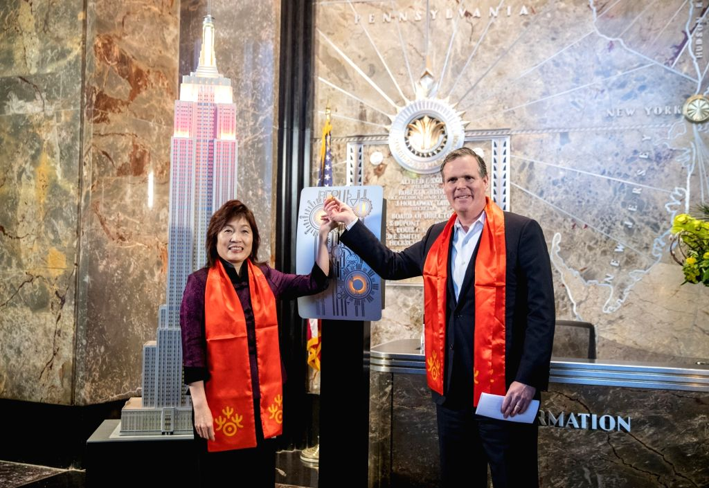 NEW YORK, Feb. 13, 2018 - Chinese Consul General in New York Zhang Qiyue (L) and John B. Kessler, President of the Empire State Realty Trust, flip the switch to light the model of Empire State ...