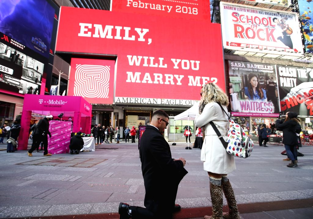 """NEW YORK, Feb. 14, 2018 - Joseph Lodato (L) proposes to Emily Gambarella during the """"Surprise Proposal"""" Valentine's Day event at Times Square in New York, the United States, on Feb. 14, ..."""