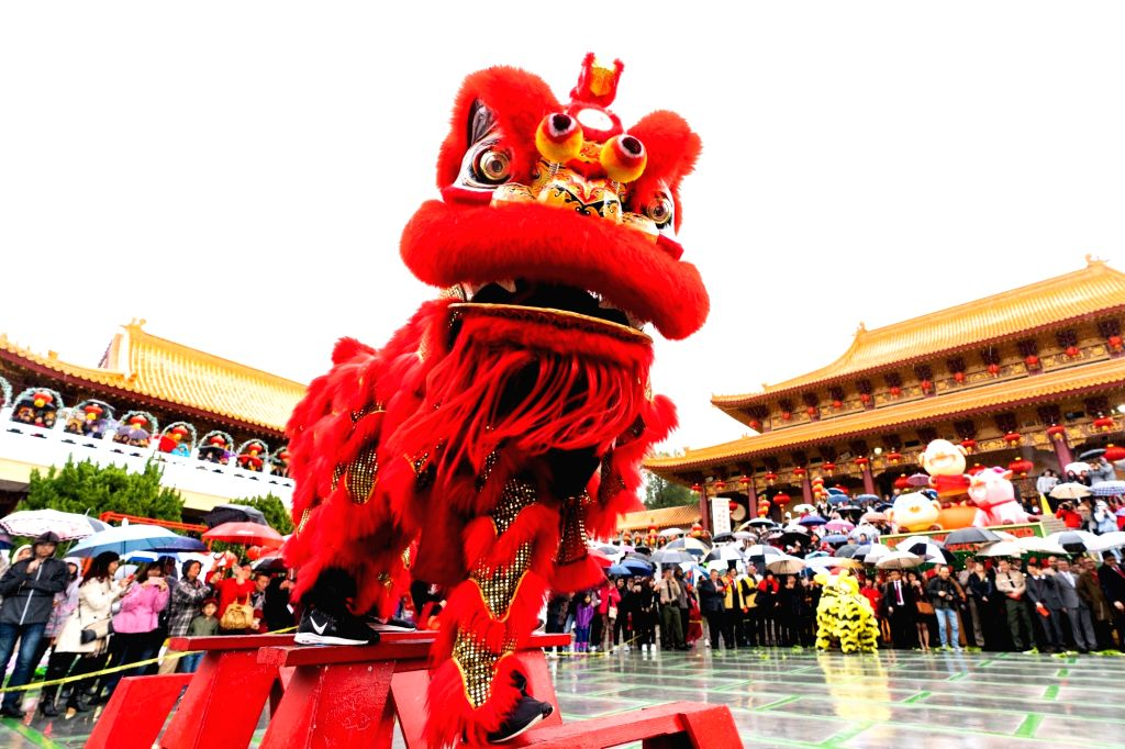 NEW YORK, Feb. 17, 2019 - People watch a lion dance on the first day of Chinese Lunar New Year at the Hsi Lai Temple in Los Angeles County, the United States, on Feb. 5, 2019. With China in festive ...