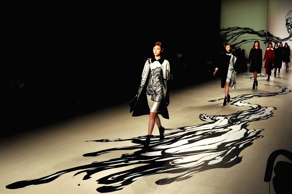 Models present creations of LieSangBong during the New York Fashion Week in New York, the United States, on Feb. 18, 2015.
