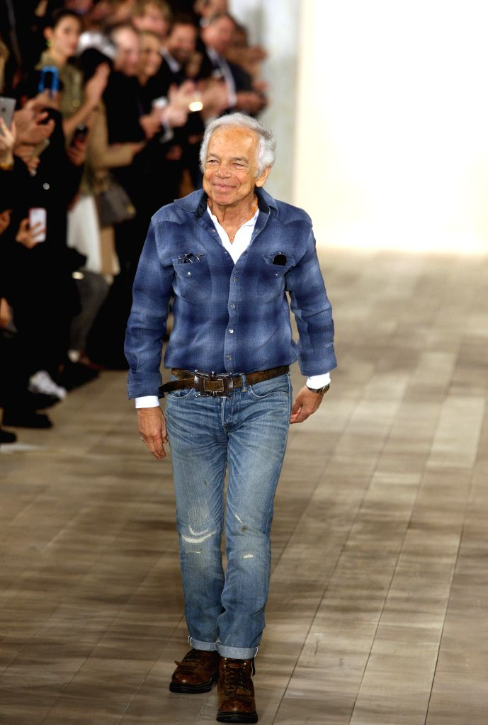 Ralph Lauren greets the audience after his brand show during the New York Fashion Week in New York, the United States, Feb. 19, 2015.