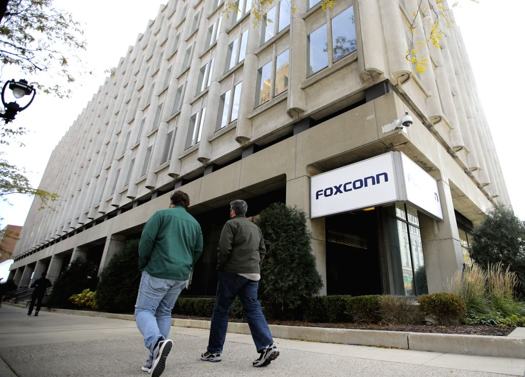 NEW YORK, Feb. 2, 2019 - People walk past an office building of Foxconn in Milwaukee, Wisconsin, the United States, Nov. 2, 2018. Residents' opposition, labor shortage, and technology transfer ...