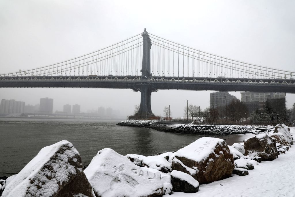 NEW YORK, Feb. 20, 2019 - The Manhattan Bridge is seen in the snow in New York, the United States, Feb. 20, 2019. More than 1,000 flights were canceled in airports across the United States Wednesday ...