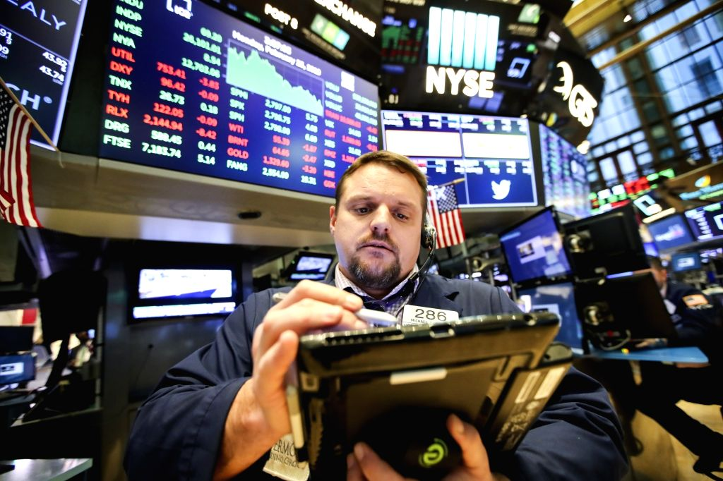 NEW YORK, Feb. 25, 2019 - A trader works at the New York Stock Exchange in New York, the United States, on Feb. 25, 2019. U.S. stocks ended higher on Monday. The Dow climbed 0.23 percent to ...