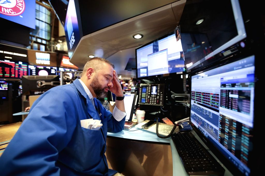 NEW YORK, Feb. 5, 2018 - A trader works at the New York Stock Exchange in New York, the United States, on Feb. 5, 2018. U.S. stocks closed sharply lower on Monday, with the Dow plummeting 4.60 ...