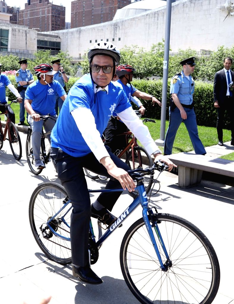 New York: India's Permanent Representative to the UN Ambassador Syed Akbaruddin rides a cycle to commemorate the World Bicycle Day during a special outdoor event organised at the UN headquarters in ...