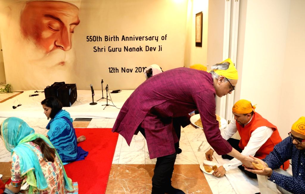 New York: India's permanent representative to the United Nations Syed Akbaruddin serves 'langar' during the 550th birth anniversary celebrations of Guru Nanak Dev in New York, US on Nov 12, 2019. - Nanak Dev