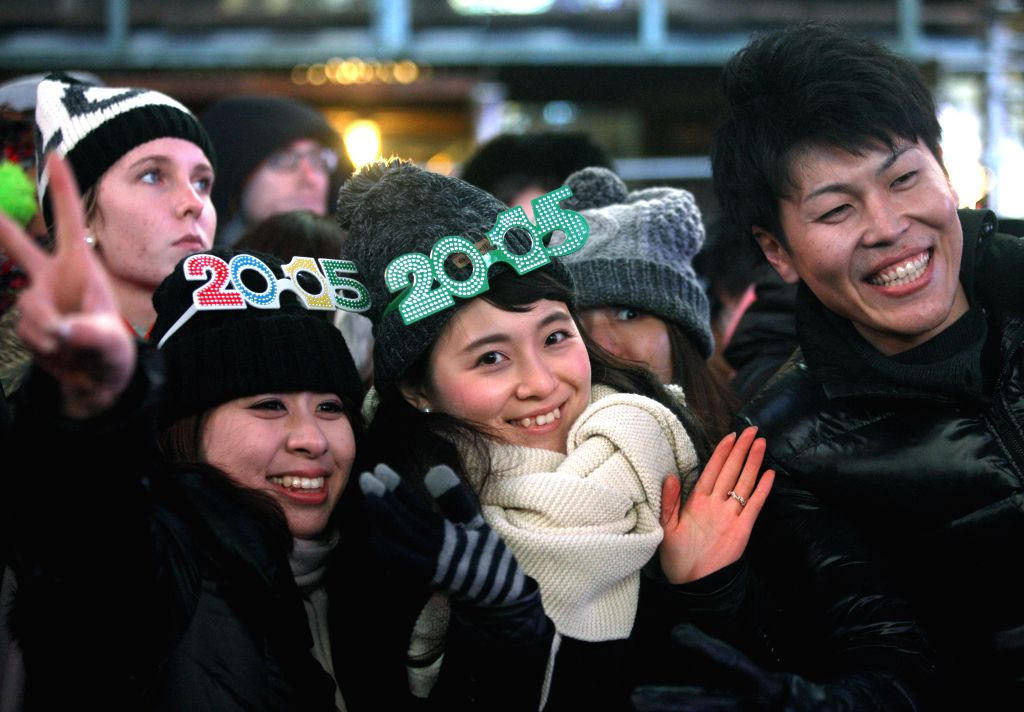 People participate in the New Year's Eve celebration at Times Square in New York, the United States on Dec. 31, 2014. Times Square has been the center of worldwide .