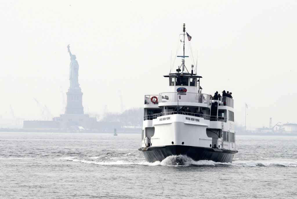 NEW YORK, Jan. 22, 2018 - Tourists return with the cruise ship after visiting the Statue of Liberty and Ellis Island in New York, the United States, Jan. 22, 2018. New York City's iconic landmark the ...