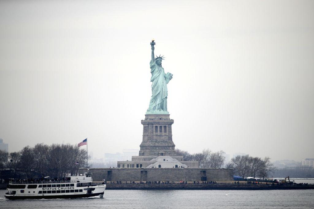 NEW YORK, Jan. 22, 2018 - Tourists visit the Statue of Liberty on Liberty Island in New York, the United States, Jan. 22, 2018. New York City's iconic landmark the Statue of Liberty reopened Monday ...