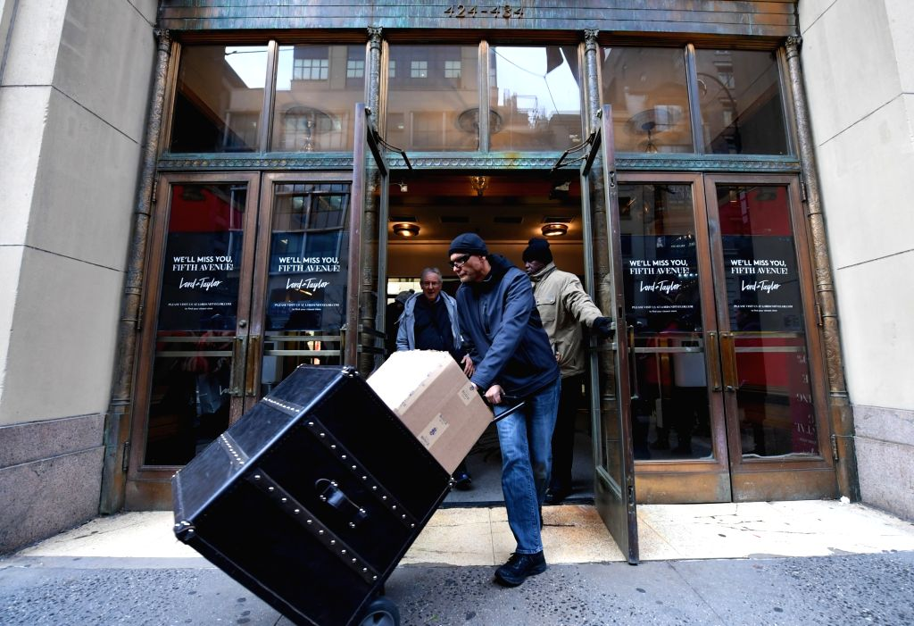 NEW YORK, Jan. 3, 2019 - A man pushes a cart out of the flagship store of the famous department store chain Lord & Taylor on Fifth avenue in Manhattan, New York, the United States, Jan. 2, 2019. ...